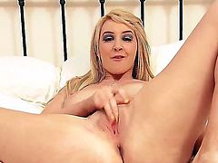 Blonde slut Katie K likes posing while deep pounding her tight vag with toys