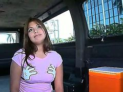Beautiful brunette girl Emily is showing her sweet small boobies on camera while the guys are filming her at the back of their van. Enjoy the sweet video.