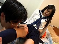 Cutie in school dress fingers her pussy like crazy while blindfolded as her man looks on and forces her to do it all.