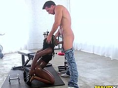 Vicky Vice is working out at her man's home gym and he rubs oil on her big, round black booty. He oils her up good and fingers her butthole. She gets down on her knees to unzip his jeans and she gives him head.