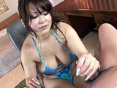 Busty Asian babe Airi Ai gives titjob like no other girl
