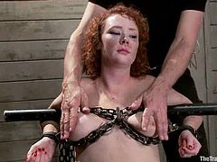 Kinky bitch gets chained and toyed with a vibrator. After that she gets hanged upside down and fucked in her mouth.