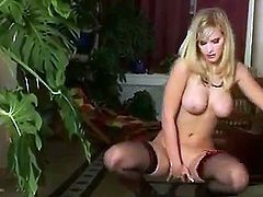 Great solo action. Staring blonde babe Marry Queen. She is beautiful, and she is feeling horny. Watch at she takes her bra off revealing her huge white tits. then she squats down and fingers her shaved pussy. Hot stuff.
