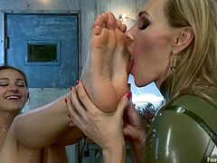 Get a load of this foot worship scene where the gorgeous Dani Daniels is forces to play with her mistress' feet.