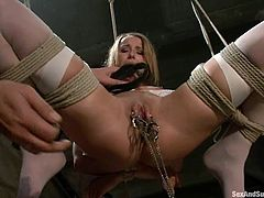 Jessie Cox loves to play filthy games. She lets Steve Holmes put her into irons and pleases him with a blowjob before he pounds her snatch from behind.