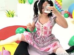 Sweet Japanese chick is having fun with some guy during a holiday. She kneels in front of him and sucks his dick till it explodes with cum in her mouth.