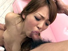 Slutty Japanese babe with mind taking body gives double blowjob while getting her bearded pussy teased with vibrator in steamy threesome sex video by Jav HD.