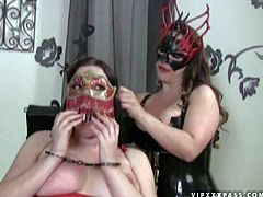 Pale dark haired curvy Anastasie Pierce with big juicy tits in red latex outfit gets tied up with head behind her head and gets her trimmed minge whipped by kinky brunette bitch