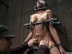 Naughty brunette girl get bonded. Then her pussy gets gaped with special clothespins. Later on the guy hands special weights on her tits.