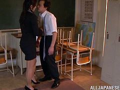 Gorgeous Japanese teacher Reiko Kobayaka is having fun with some guy in a classroom. Reiko kisses and licks the man's body and then gives him a nice handjob.
