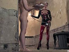 This bondage video has the naughty blonde Maitresse Madeline in hot latex outfit spanking and pegging a tied up dude.