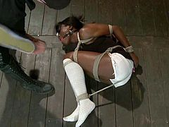 Sexy ebony chick Ana Foxxx lets some hot girl bind and suspend her in a basement. The dominatrix torments Ana and then fists her vag and drills it with a dildo.