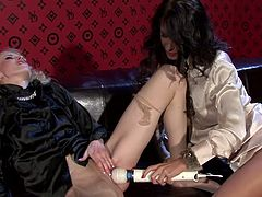 Peppering blond whore with long curly hair moans with pleasure and rolls her eyes while getting her pinkish cunt teased with vibrator in sultry lesbian sex video by Tainster.