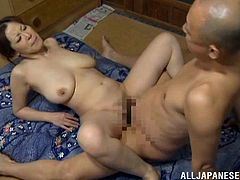 Japanese milf is having a good time with her husband indoors. They pet each other and then bang in cowgirl and missionary positions.