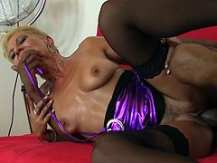 Blonde whore Elenia is mature and still horny and ready to fuck. She mostly prefers black meat and when she gets a big black cock Elenia starts to be insanely horny. She's now being stuffed sideways from this black dude and moans with pleasure as he goes deep in her pussy, stretching her with his bbc.