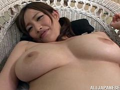 The sexy Japanese MILF with nice big tits Moe Tsukina is giving a blowjob and titjob to a cock in this hot video.