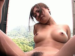Horny and kinky Japanese cutie Aika bends over and a guy pleases her with a vibrating dildo. Her hairy cunt wants to be pounded!