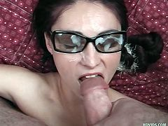 Dorky chick Alesha lays on her back as I fuck her between those sweet titties. She likes having a big hard cock between her breasts but further more this cutie enjoys a big warm load on her slutty face. A few more strokes and I give her what she deserves, covering her pretty face and those glasses with my jizz