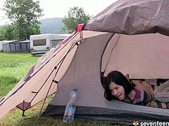 This cute 17 year old girl is half naked inside her tent. She is rubbing her pussy until she has an intense orgasm.