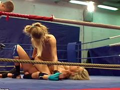Naked blonde babes Laura Crystal and Michele Moist with perfectly shaped body figures and nice natural hooters get filmed by dirty referee during amazing chick fight in the ring