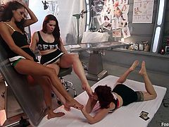 Get a load of this foot worshiping scene where two hot redheads make an even hotter brunette worship their feet before having a lesbian threesome.