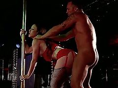 Big guy Marcus London is standing on the stage in front of the marvelous stripper Jennifer White, which is doing a hot dance for him and a nice blowjob.
