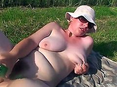 Jessica is a big girl with appetizing big boobs and beautiful pale skin, but her large forms dont prevent her from doing things she loves using a glass bottle!
