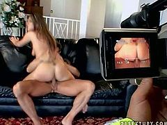 Beautiful long haired brunette baby sitter with slutty back tattoos rides on turned on dude with muscled body on leather couch while his blonde hot ass wife is filming everything