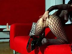 Hot tempered brunette babe in fishnet costume trains her asshole with fingers before she sticks a massive dildo inside for an intensive drill.
