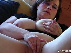 Busty sensual mature rubbing her pink bald cunt in close-up