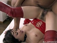 Sex hungry Japanese girl in latex corset and stockings gives a blowjob to older man and then rides his dick passionately.