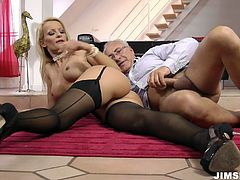 She is stunning blond hottie wearing tempting black lingerie. She is poked actively from behind fucking furiously in a spicy Jim Slip porn vid.