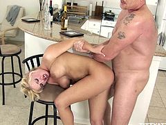 Andi Anderson s getting tit fucked and banged hard in the kitchen. Watch this MILF ending with cum all over her tits in this hardcore clip.
