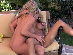 Zealous sexy gals Ainsley Addison & Nicole Graves eat each other on the couch