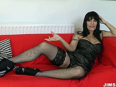 Full figured brunette MILF Daisy Rock stuns with her mad curves. She looks very hot in her stockings and black corset. Watch her stroking her fat pussy.