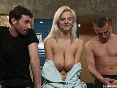 James Deen and Mr. Pete are having fun with a slutty blonde in the locker room. They bound the bitch and play with her cunt before smashing it with their cocks.