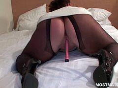 Busty mature in pantyhose vibing her peachy cunt to orgasm