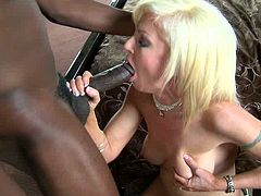 Blonde gets pounded by black cock and made to swallow huge load after a good fuck