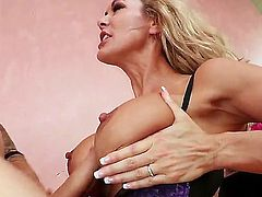 Brandi Love with juicy boobs sucks like a pro in steamy oral action with Criss Strokes