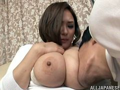 Big-breasted Japanese hussy Reiko Yumeno shows her enormous boobs to her BF and lets him knead them. Then she kneels in front of him and drives him mad with a fantastic titjob.