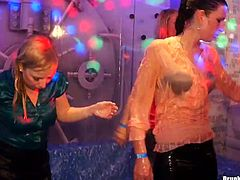 Worn out white milfs rub over each other in soaking wet clothes