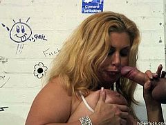 She is fat blonde hoe with big natural boobs. She rubs her pussy sitting in the public toilet. Then she fucks doggy style taking hard dick sticking out the gloryhole. Then she blows the tool.