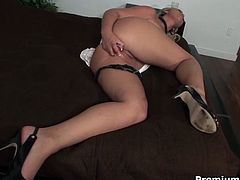 Curvy blond milf Abbey Brooks drills her shaved cunt with dildo