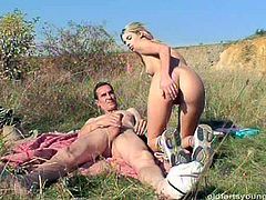 Naive blond chic gets lured by a horny dude as she takes sunbath outdoors. She rides him in reverse cowgirl style before she stands in doggy pose for a poke from behind.