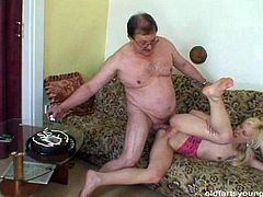 Fat hairy daddy pokes stretched pinkish cunt of skinny blond whore in sideways pose before she rides him in reverse cowgirl style and later cumshots into her dirty mouth.