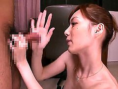 Cute Asian brunette babe Kaede Fuyutsuki naughtily pleasing boyfriends cock by fondling it in her hands and then passionately sucking it deep