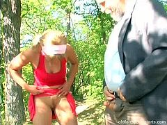 Horny bearded grandpa takes a stroll in park where he meets a mesmerizing blond fairy. She kneels down in front of him to do the magic with his weak dick before he pays her back with a blowjob.