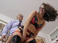 She is trashy trollop wearing fishnet stockings and black leather jackboots. She sucks the rod of a geezer and then gets poked actively from behind.