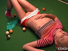 Playful cutie Sasha masturbating bald pussy on a pool table