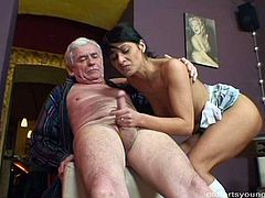 After riding a nasty hard cock of grey-haired grandpa in reverse cowgirl style, rapacious brunette hoe bends over a table to get fucked in doggy and missionary styles.